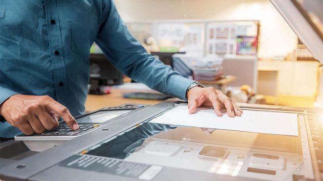 Document scanning specialist scanning images at Didlake Imaging in Manassas, Virginia.