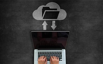 Worker accessing digital documents through cloud storage.