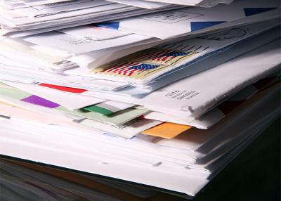Mail piling up to be stored in a digital mailroom